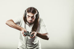 Stressed man playing on pad Royalty Free Stock Photos
