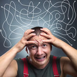 Stressed man. Portrait of stressed man with many arrows pointed in different directions Royalty Free Stock Image