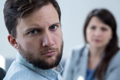 Stressed man during psychotherapy Stock Image