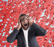 Stressed man with questions Royalty Free Stock Images