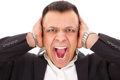 Stressed man screaming holding his head Stock Photo
