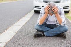 Stressed man sitting on the ground Stock Photos