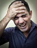 Stressed man with a strong headache Royalty Free Stock Images