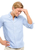 Stressed man suffering from headache isolated on white backgroun Stock Image