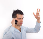 Stressed man talking on cell phone Stock Image