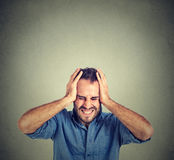 Stressed man upset frustrated. Negative human emotions Stock Image