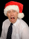 Stressed Man Wearing Santa Hat Royalty Free Stock Images
