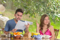 Stressed man and woman arguing about family budget Stock Images
