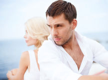 Stressed man with woman outside stock photography