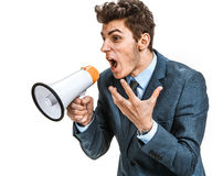 Stressed man yelling through a megaphone Royalty Free Stock Photo
