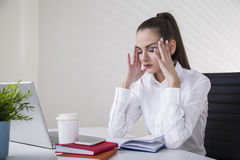 Stressed manager in her office Stock Photography