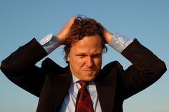 Stressed manager or salesman. Picture showing stressed manager or salesman pulling his hairs Royalty Free Stock Photos