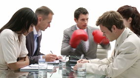 Stressed manager wearing boxing gloves stock footage