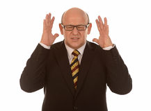 Stressed mature businessman Stock Photos