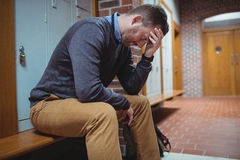 Stressed mature student sitting in locker room Stock Images