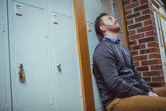Stressed mature student sitting in locker room Stock Image