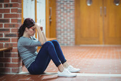 Stressed mature student sitting in locker room Royalty Free Stock Photography