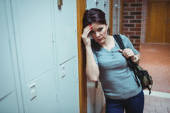 Stressed mature student standing in locker room Royalty Free Stock Image