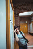 Stressed mature student standing in locker room Royalty Free Stock Images