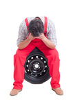 Stressed mechanic resting head in hands Royalty Free Stock Photos