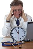 Stressed medical doctor under time pressure Royalty Free Stock Photo
