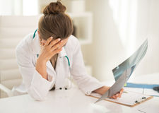Stressed medical doctor woman with fluorography Stock Images