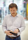 Stressed middle age man holding purse with russian paper money Stock Photography