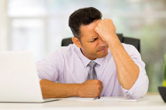 Stressed middle aged businessman Royalty Free Stock Image