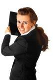 Stressed modern business woman brandishing laptop Stock Photography
