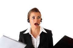 Stressed modern business woman with headset Stock Photography