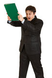 Stressed modern businessman brandishing folder Royalty Free Stock Photos
