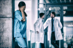 Stressed nurse standing in hospital Royalty Free Stock Photography