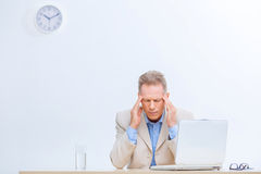 Stressed office worker having a headache Stock Photos