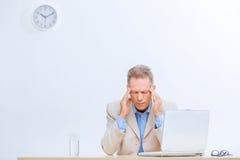 Stressed office worker having a headache Stock Photos
