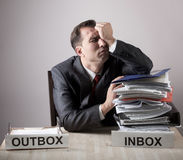 Stressed office worker with a paper stack. Stress concept Stock Images