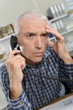 Stressed office worker on phone Stock Images