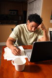 Stressed out. A man stressed out about paper work with laptop computer Royalty Free Stock Photography