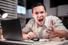 Angry emotional man wanting to quit the job. Stressed out. Angry emotional man shouting while wanting to quit the job stock photos