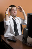 Stressed out Business man. At desk Stock Image