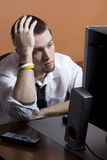 Stressed out Business man. At desk Royalty Free Stock Images