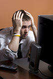 Stressed out Business man. At desk Royalty Free Stock Photo