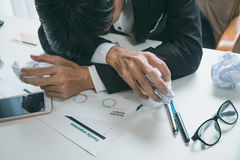 A stressed out business man holds his head in despair Stock Photos