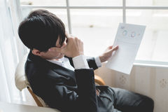 A stressed out business man holds his head Stock Photography