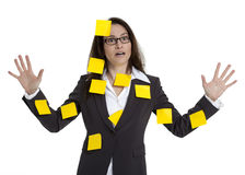 Stressed Out Business Woman on White. Stressed out business woman with numerous post-it notes stuck on her. White background stock photography