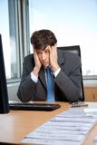 Stressed Out Businessman. Sitting at his desk in front of computer Stock Images