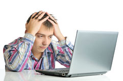 Stressed out businessman. A man holding his head in frustration while working on his computer Royalty Free Stock Photo
