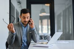 Free Stressed Out Businessman In Office Making Important Phone Call About Serious Problem Working Under Pressure And Tight Deadline Stock Photos - 155845233