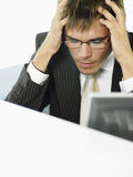 Stressed-Out Businessman In Office Stock Images
