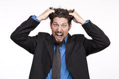Stressed out businessman pulling his hair and screaming Stock Images