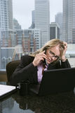 Stressed-Out Businesswoman Royalty Free Stock Images